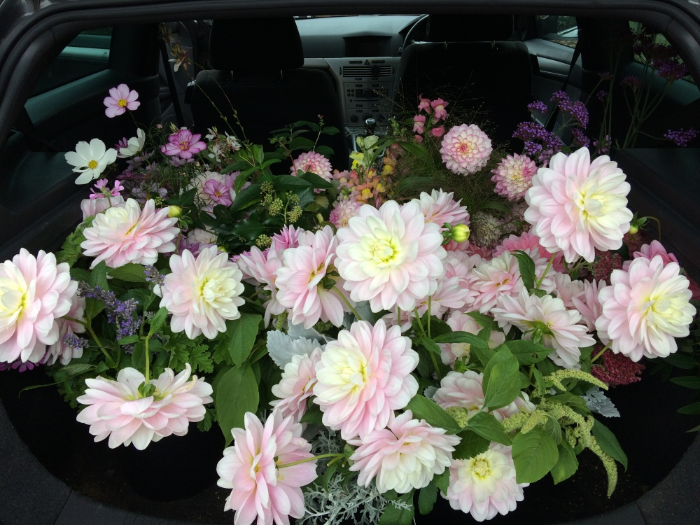 A Brides car boot full of British Wedding Flowers ready for her Buckinghamshire Wedding