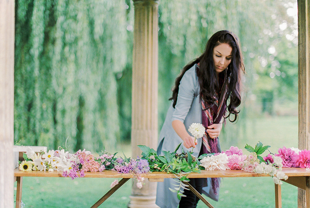 Alexandra Rose laying out her Bucket of British Flowers from Swan Cottage Garden and Flower Farm