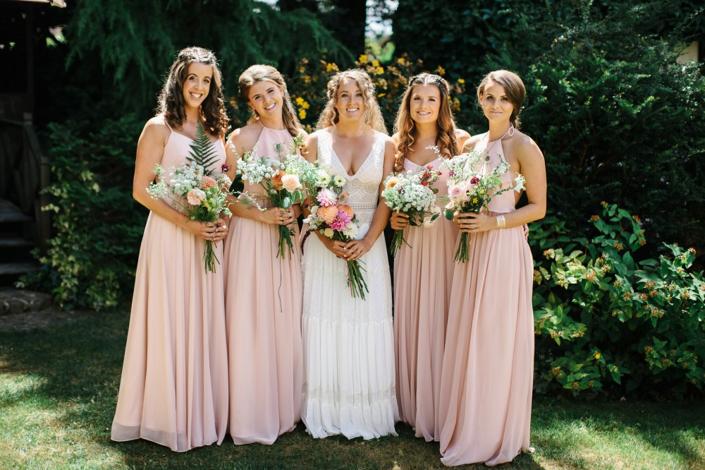 Bride Claire with her Bridesmaids holding their beautiful handmaid bouquets