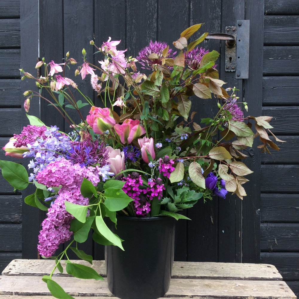 A bucket of Natural Seasonal British Flowers, fresher than imported blooms and far more varied