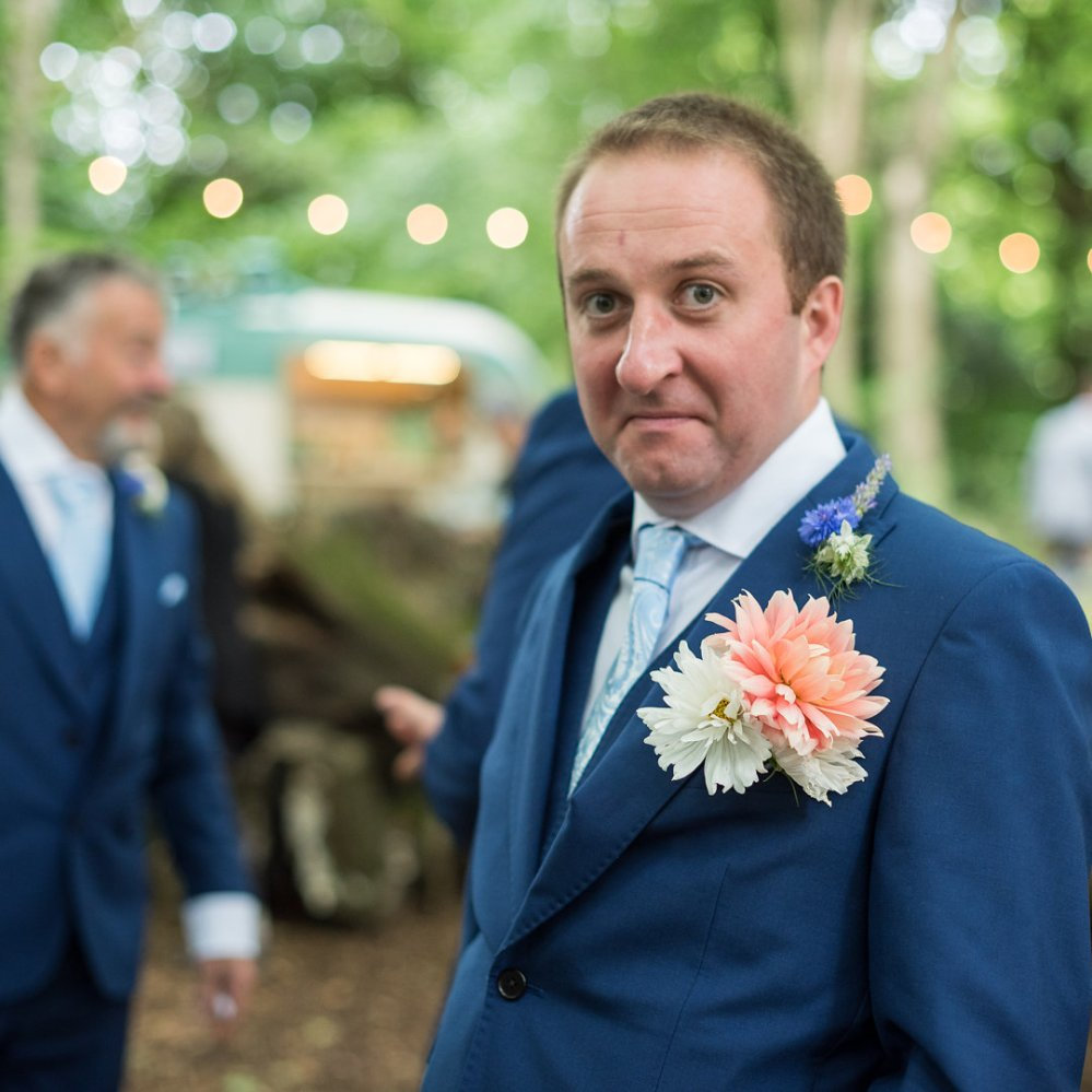 The best man looking dapper with a Flower Girl Posy tucked into his buttonhole!