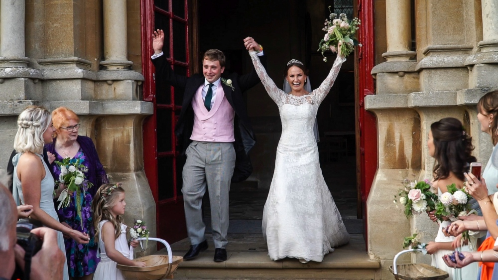 Sophie and Ed hands+up+in+doorway
